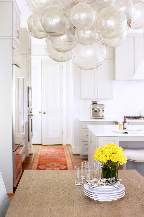 Gray Glass Bubbles Chandelier Over Dining Table