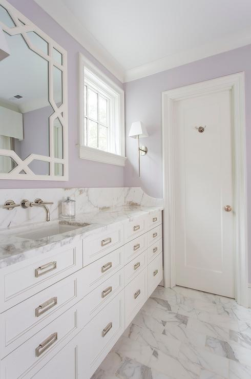 Lavender Painted Bathroom with Marble and White Cabinets