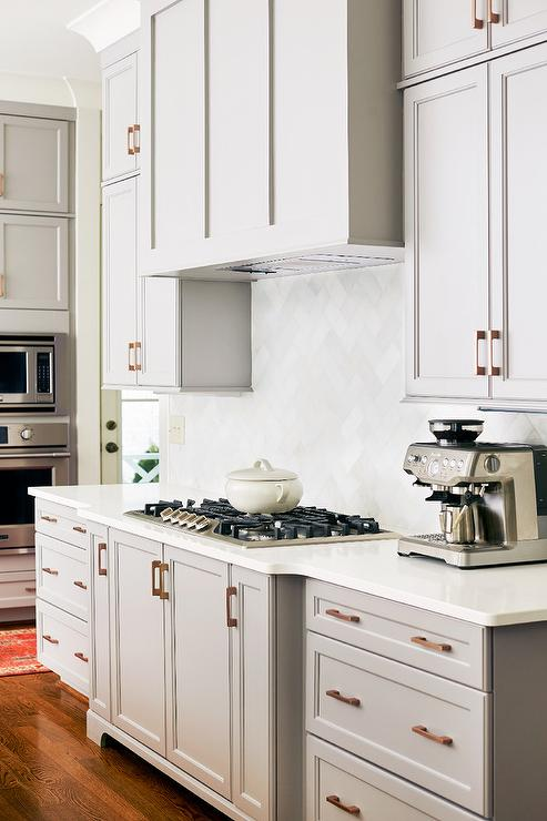 Grsya Shaker Cabinets With White Quartz Transitional