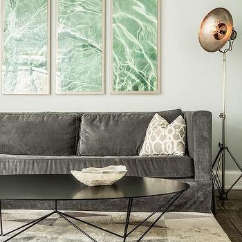 Dark Blue Velvet Sofa With Black And White Pillows