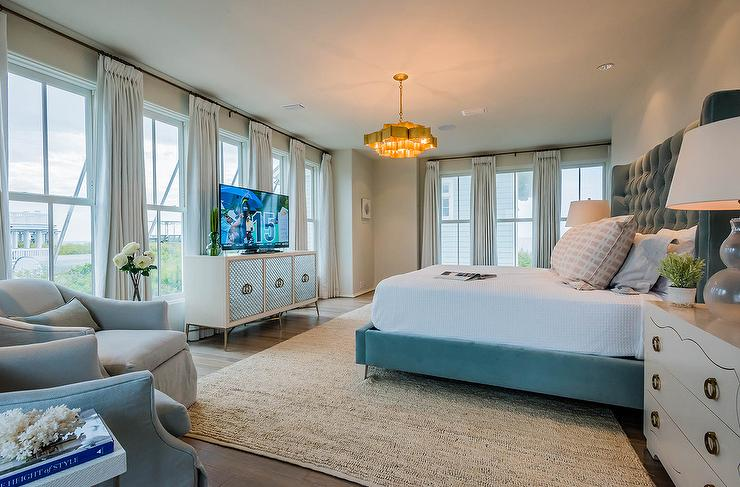 A Currey Co Grand Lotus Chandelier Illuminates Tall Blue Velvet Wingback Bed Flanked By White 3 Drawer Dressers As Nightstands Bungalow 5 Isabella