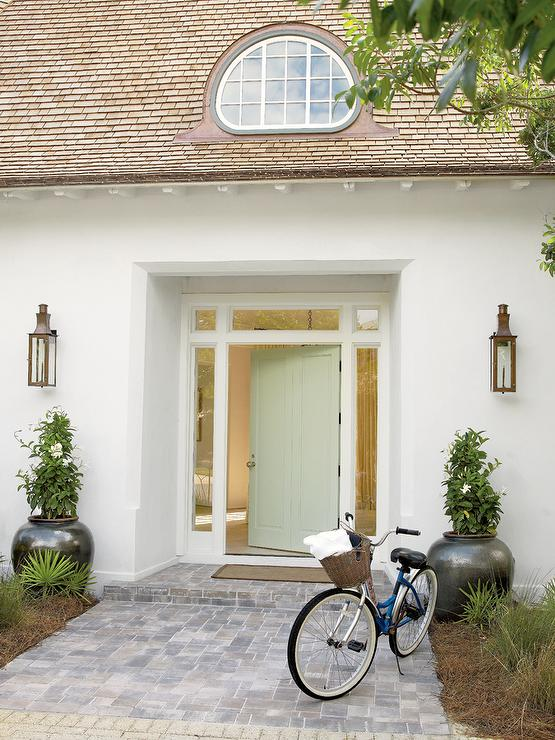 White Beach Home with Light Green Front Door - Cottage - Home Exterior