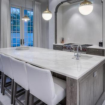 Gray Wire Brushed Kitchen Island With White Counter Stools