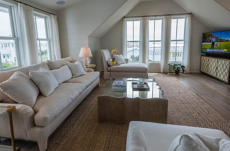 Attic Tv Room Boasts An Oatmeal Linen Roll Arm Sofa Flanked By Brass  Corners End Tables, Bernhardt Brielle End Tables, Facing A Mirrored Top  Coffee Placed ...