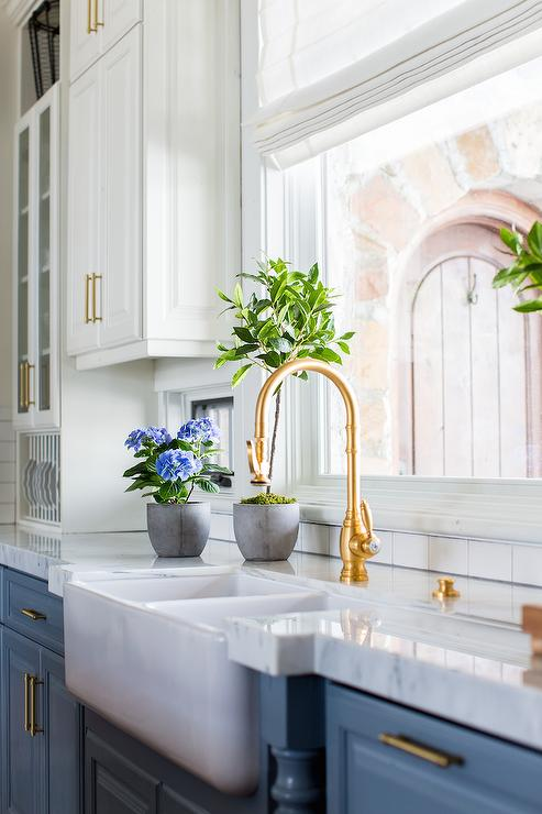 Blue Cabinets With Antique Brass Gooseneck Faucet