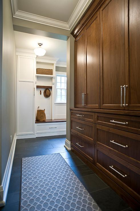 Floor To Ceiling Brown Stained Mudroom Cabinets