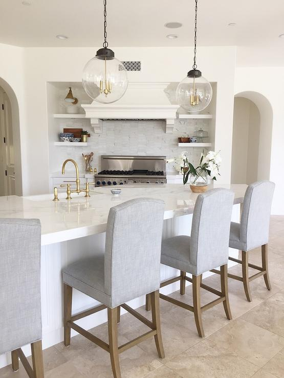 Gray Camelback Counter Stools With Angled Center Island