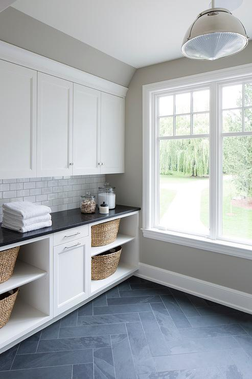 White Laundry Cabinets With Gray Slate Herringbone Floor