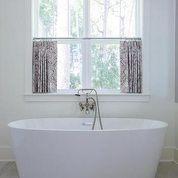 oval bathtub on gray wood like floor tiles - Purple Cafe Ideas