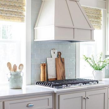 Blue kitchen island with wood and iron barstools for Light blue kitchen backsplash