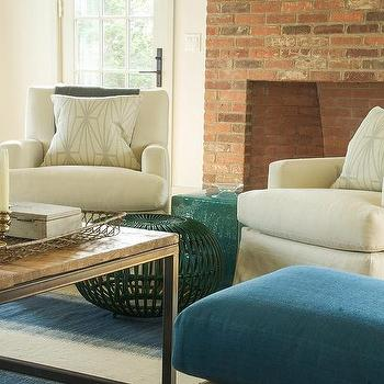 Off White Chairs In Front Of Red Brick Fireplace