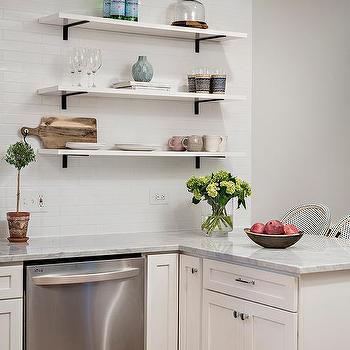 Stacked Marble Kitchen Shelves With Iron Brackets