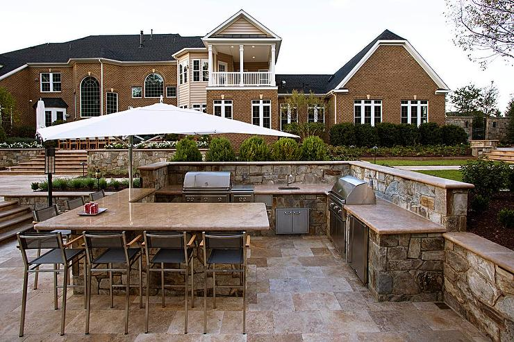 outdoor kitchen countertops stone fieldstone outdoor kitchen is topped with brown granite countertops fitted dual bbq grills and prep sink outdoor kitchen design ideas