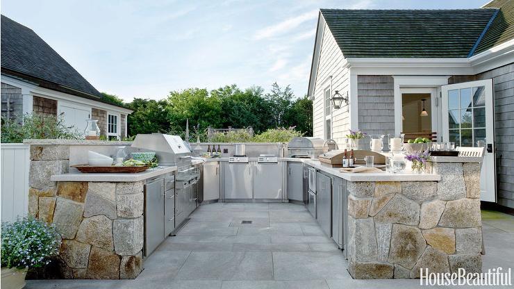 outdoor kitchen with stainless steel mini brick tile backsplash