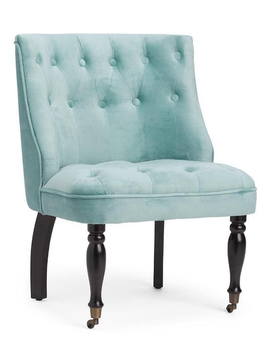 curved blue velvet tufted chair