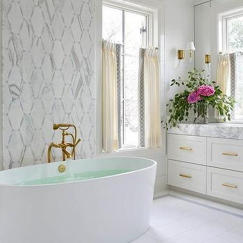 oval bathtub in front of marble mosaic wall - Bathroom Accent Wall