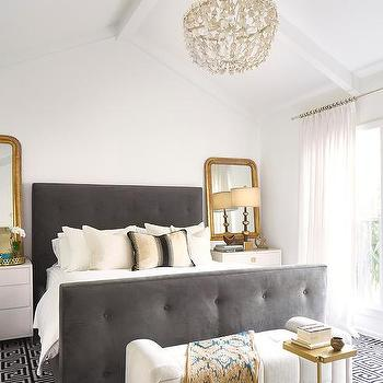 Shabby slips austin · white chandelier over dark gray velvet tufted bed with footboard