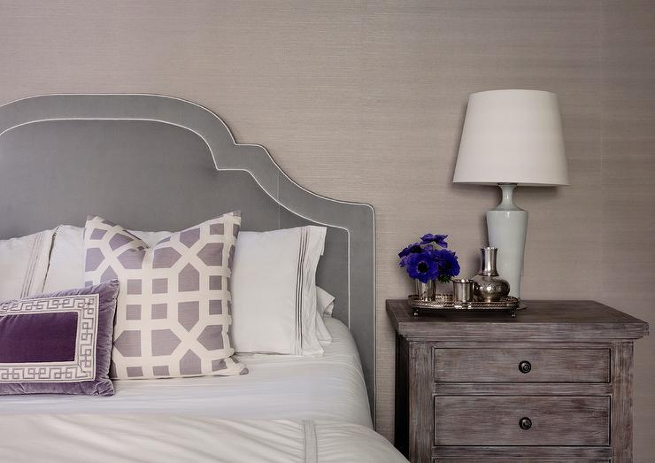 Gray Velvet Headboard With Purple Pillows