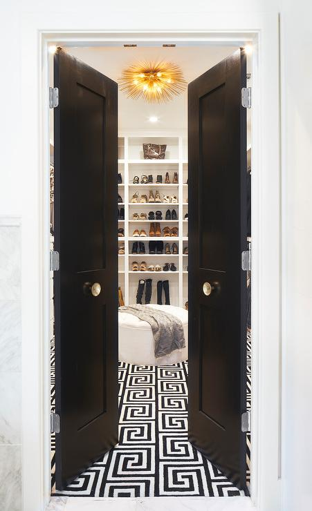 Black Bi Fold Closet Doors With Gold Door Knobs