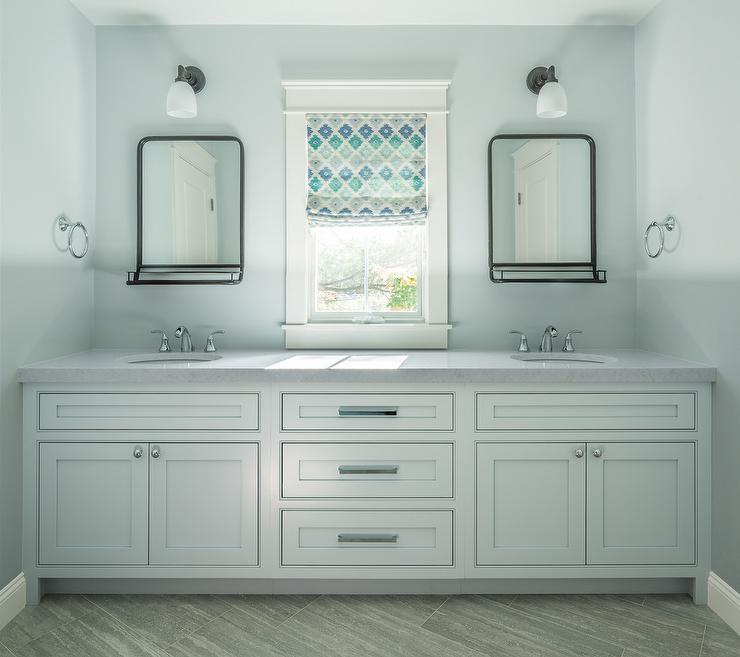 Soft Blue Bathroom With Bronze Mirrors With Trays