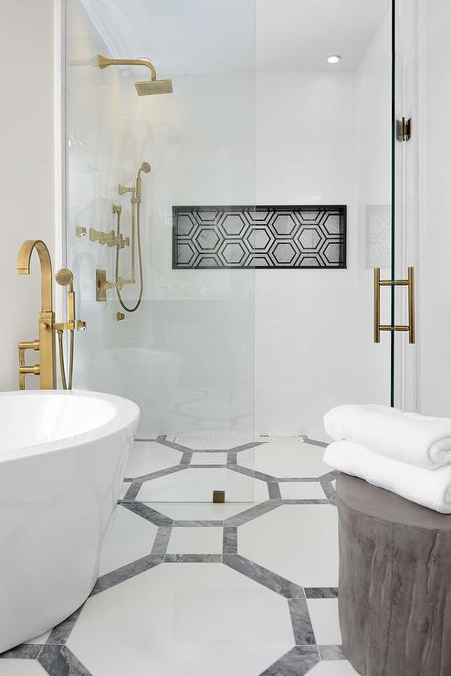 black and white hex tiled shower niche
