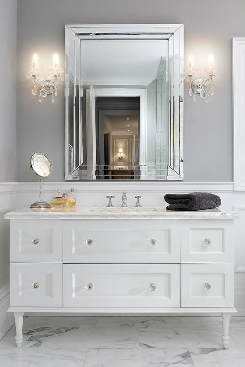 Attrayant Two Crystal Sconces Illuminate A White Washstand With Legs Adorned With Crystal  Knobs Topped With White Marble Fitted With A White Porcelain Rectangular ...