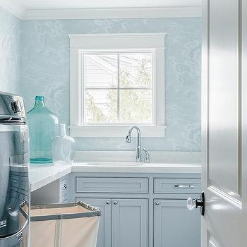 'Blue Laundry Room Cabinets' from the web at 'https://cdn.decorpad.com/photos/2017/04/27/m_blue-laundry-room.jpg'