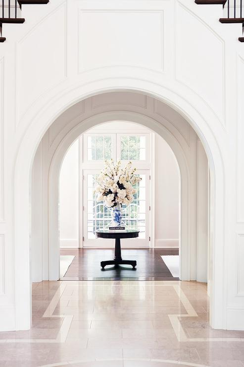 Arch Foyer Doorway With Black Pedestal Table