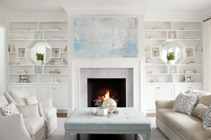 Blue Abstract Art Over Carrera Marble Fireplace