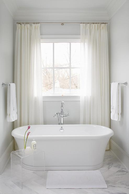Marvelous White Sheer Curtains Behind Oval Bathtub