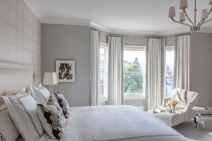 White and gray hotel bedding with pink pillows for Bay window chaise lounge