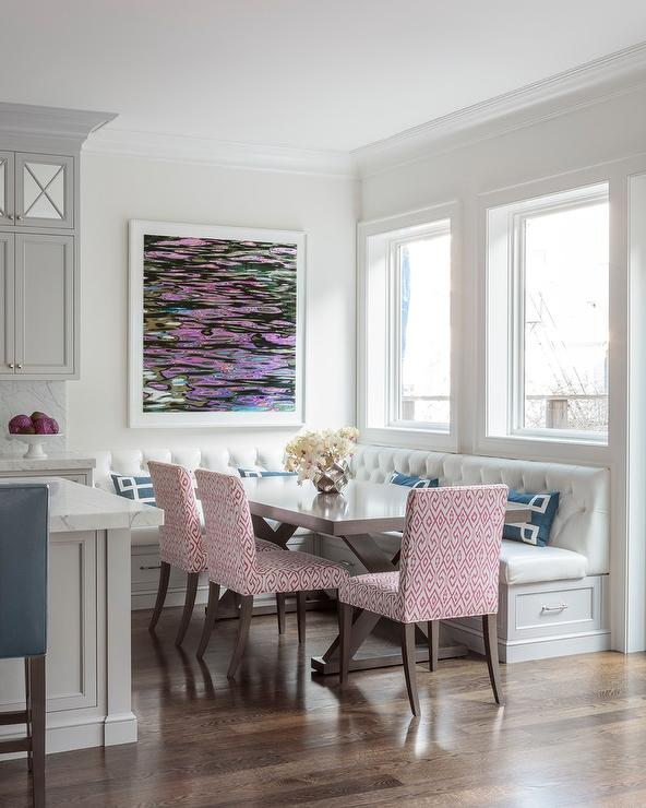 Welcoming White Kitchen Is Illuminated By Regina Andrew: L Shaped Tufted Banquette