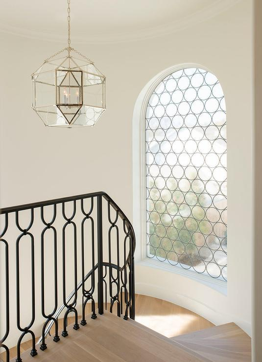 Winding Staircase With Arched Window