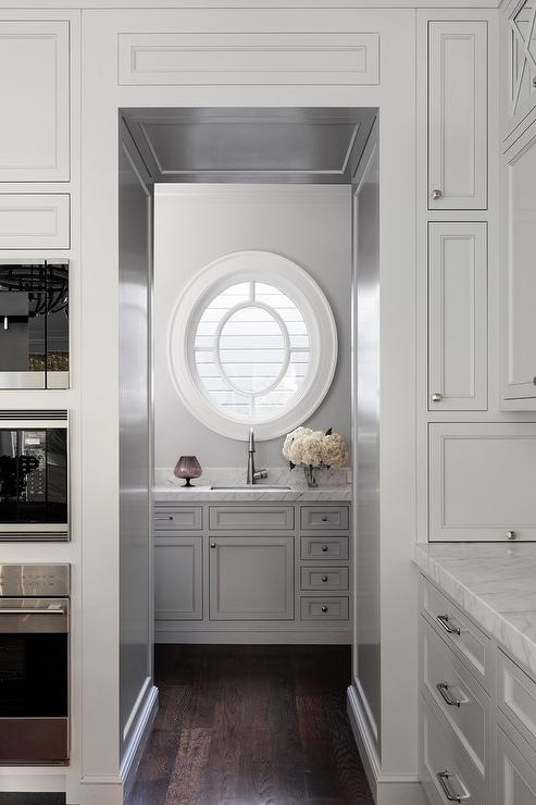 Oval Window Over Pantry Sink Transitional Kitchen