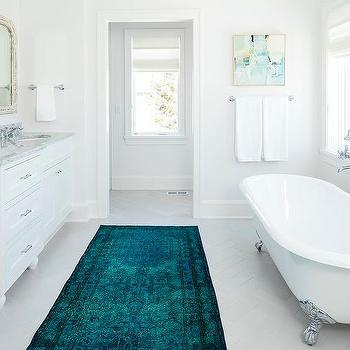 turquoise blue overdyed rug in white bathroom