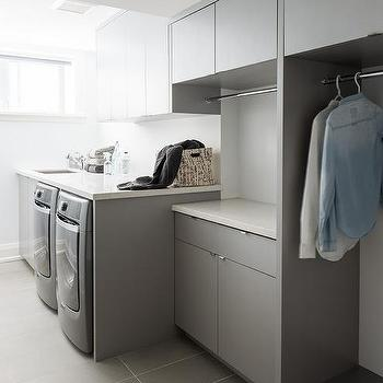 White Modern Laundry Room With Gray Staggered Floor Tiles