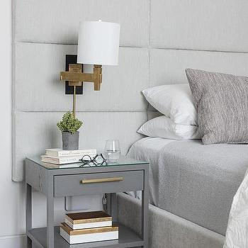 Sconces Mounted On Gray Headboard