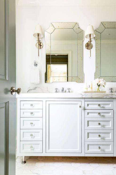 Large Marble Octagonal Tiles Lead To A White Double Washstand Adorned With  Glass Knobs Topped With White Marble Fitted With His And Her Sinks Placed  Under ...
