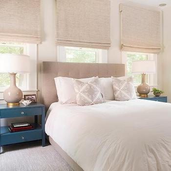 Beige Tufted Headboard With Blue Nightstands