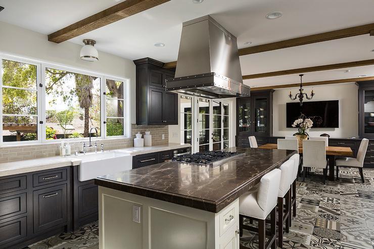 Mediterranean Kitchen With Brown Marble Countertop