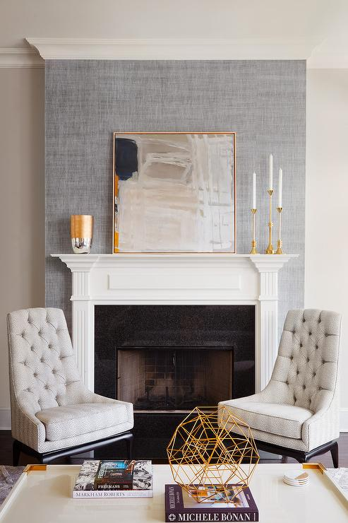 Gray Abstract Art Leaning On Fireplace Mantel