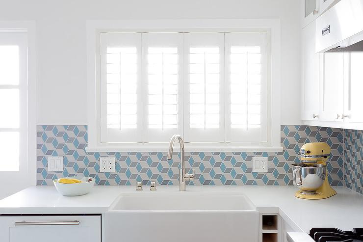 Blue Geometric Tiles With White Cabinets