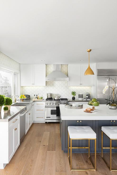 Crisp White Cabinets Go To The Ceiling In This White Kitchen And Create A  Spacious Feel, While White Beehive Backsplash Tiles Frame The Walls Around  ...