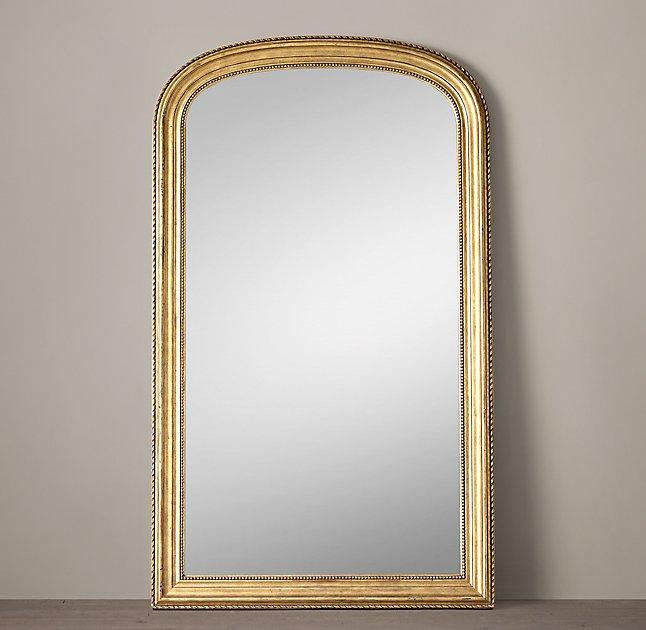 gilt arched crown leaner mirror
