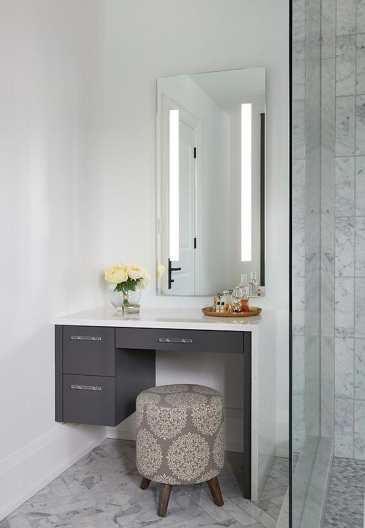 White Makeup Vanity With Gray Waterfall Countertop Transitional Bathroom