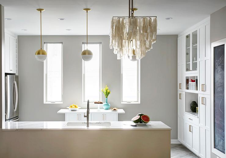 Kitchen Island Against Wall white and gold kitchen peninsula pendants - contemporary - kitchen