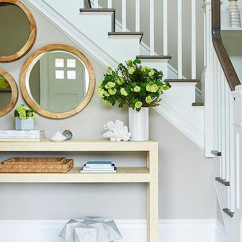 https://cdn.decorpad.com/photos/2017/05/11/m_gold-raffia-console-table-with-staggered-mirrors.jpg