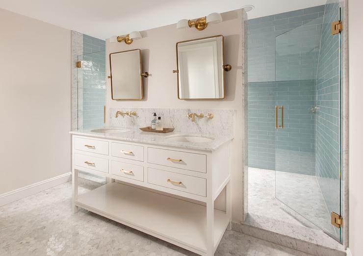 white washstand with brass pivot mirrors