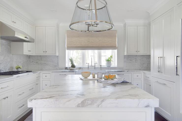 White U Shaped Kitchen With Marble Slab Backsplash