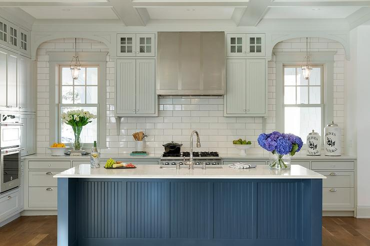 Light Gray Beadboard Cabinets Go To The Ceiling In This White Kitchen With  Curved Window Frame Moldings Creating A Spacious Feel, While The Large Blue  ...
